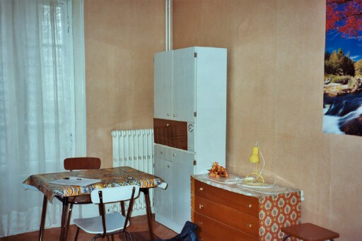 ...my table and chairs again, as well as my pantry/dish cabinet and my chest of drawers.  This picture was taken before I had moved in, which explains the lack of crap on the top of the chest of drawers.  Isn't it nice (and accidental) how the poster matches up between this picture and the one of...