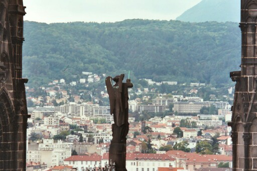 View from the top of the cathedral in Clermont-Ferrand - is it just me or does this angel have a lightsaber?