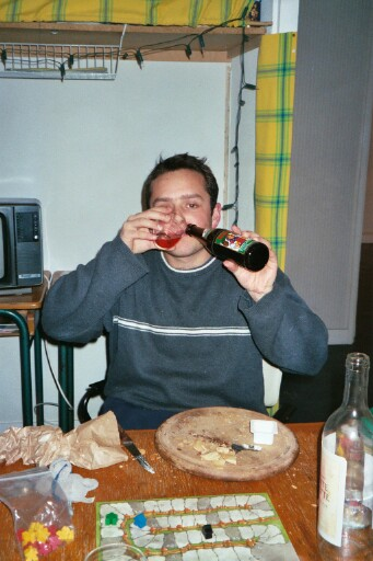 Stefan demonstrating his dual cultural nature by drinking both wine and beer at the same time