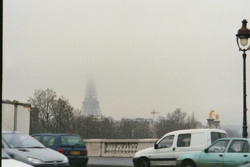 the Eiffel Tower, half-missing in the fog